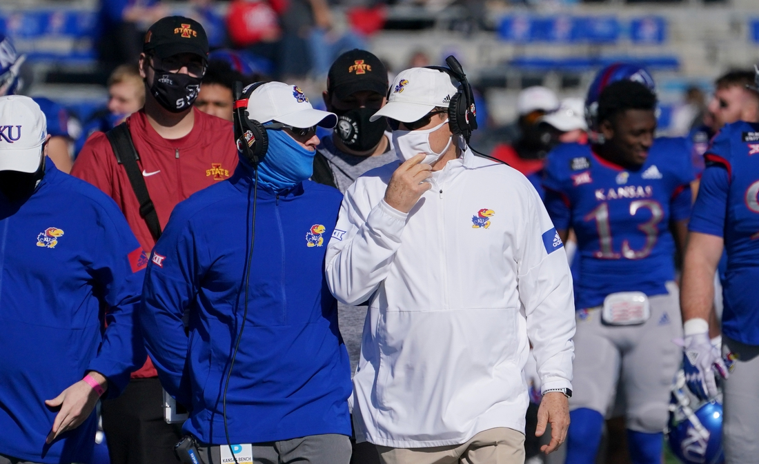 Oct 31, 2020; Lawrence, Kansas, USA; Kansas Jayhawks head coach Les Miles talks with an assistant on the sidelines during the game against the Iowa State Cyclones at David Booth Kansas Memorial Stadium. Mandatory Credit: Denny Medley-USA TODAY Sports