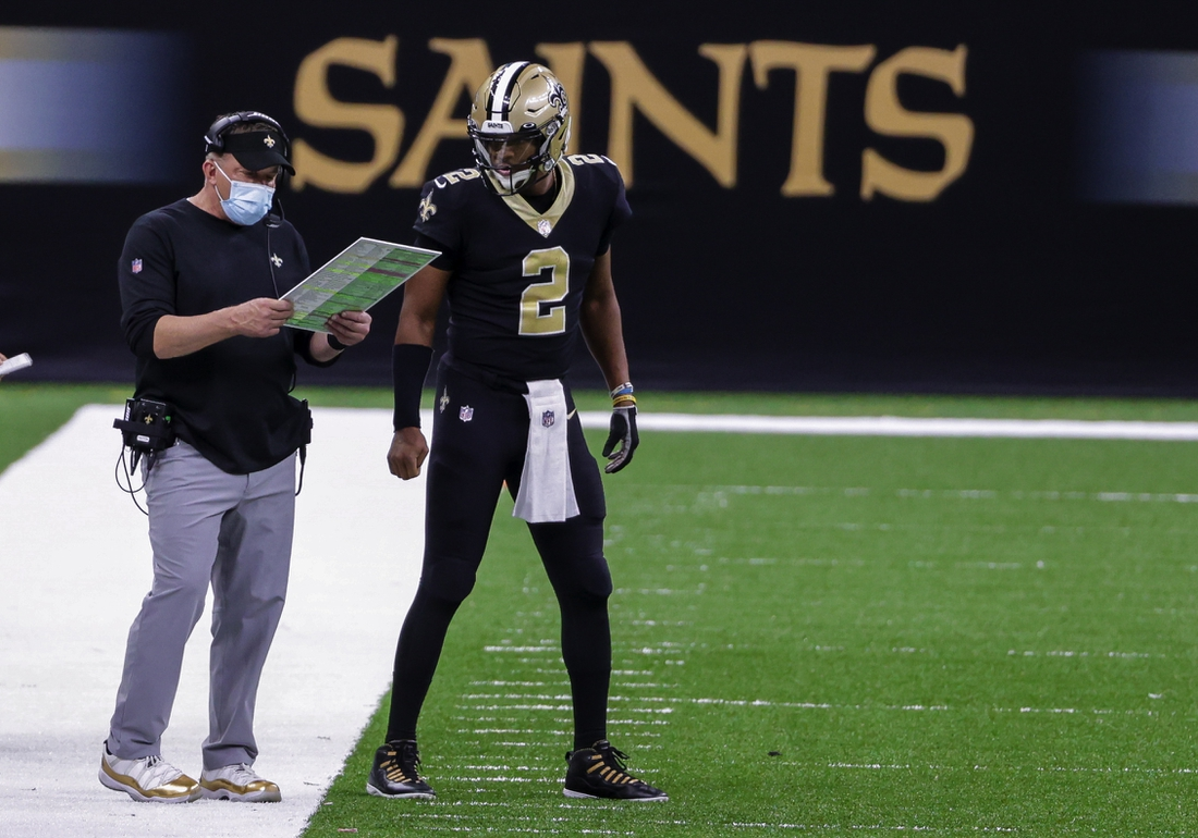 Nov 15, 2020; New Orleans, Louisiana, USA; New Orleans Saints head coach Sean Payton and quarterback Jameis Winston (2) talk on the sideline during the second half against the San Francisco 49ers at the Mercedes-Benz Superdome. Mandatory Credit: Derick E. Hingle-USA TODAY Sports