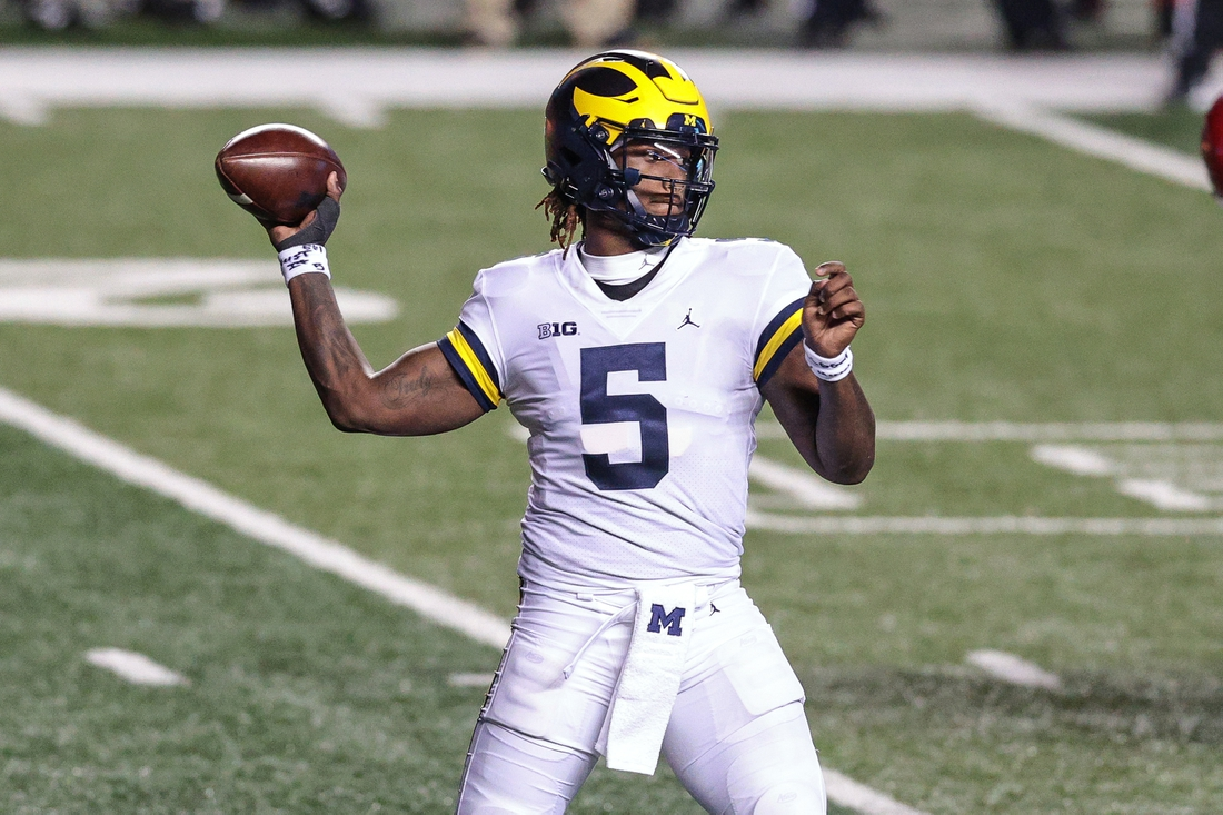 Nov 21, 2020; Piscataway, New Jersey, USA; Michigan Wolverines quarterback Joe Milton (5) throws the ball against the Rutgers Scarlet Knights during the first half at SHI Stadium. Mandatory Credit: Vincent Carchietta-USA TODAY Sports