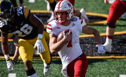 Nov 27, 2020; Iowa City, Iowa, USA; Nebraska Cornhuskers quarterback Luke McCaffrey (7) runs the ball as Iowa Hawkeyes defensive back Kaevon Merriweather (26) gives chase during the first quarter at Kinnick Stadium. Mandatory Credit: Jeffrey Becker-USA TODAY Sports