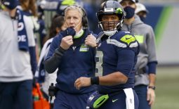Dec 6, 2020; Seattle, Washington, USA; Seattle Seahawks quarterback Russell Wilson (3) walks back to the sideline following a failed third down play against the New York Giants during the second quarter at Lumen Field. Seattle Seahawks head coach Pete Carroll stands behind Wilson. Mandatory Credit: Joe Nicholson-USA TODAY Sports