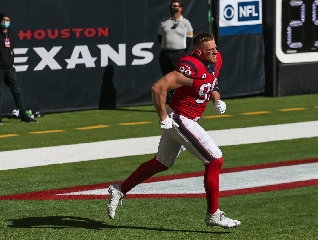 Dec 6, 2020; Houston, Texas, USA; Houston Texans defensive end J.J. Watt (99) runs onto the field before the game against the Indianapolis Colts at NRG Stadium. Mandatory Credit: Troy Taormina-USA TODAY Sports