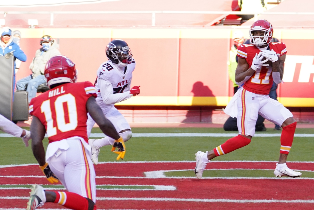 Dec 27, 2020; Kansas City, MO, USA; Kansas City Chiefs wide receiver Demarcus Robinson (11) catches a pass for a touchdown against Atlanta Falcons defensive back Kendall Sheffield (20) in the fourth quarter of a NFL game at Arrowhead Stadium. Mandatory Credit: Denny Medley-USA TODAY Sports