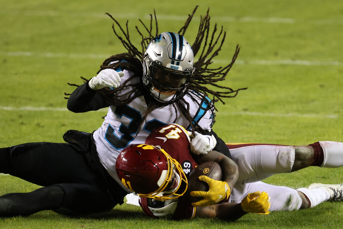 Dec 27, 2020; Landover, Maryland, USA; Washington Football Team running back J.D. McKissic (41) is tackled by Carolina Panthers free safety Tre Boston (33) in the fourth quarter at FedExField. Mandatory Credit: Geoff Burke-USA TODAY Sports