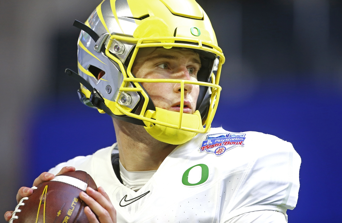 Jan 2, 2021; Glendale, AZ, USA;   Oregon quarterback Tyler Shough (12) throws passes before the Fiesta Bowl game against Iowa State at State Farm Stadium.  Mandatory Credit: Patrick Breen-USA TODAY Sports