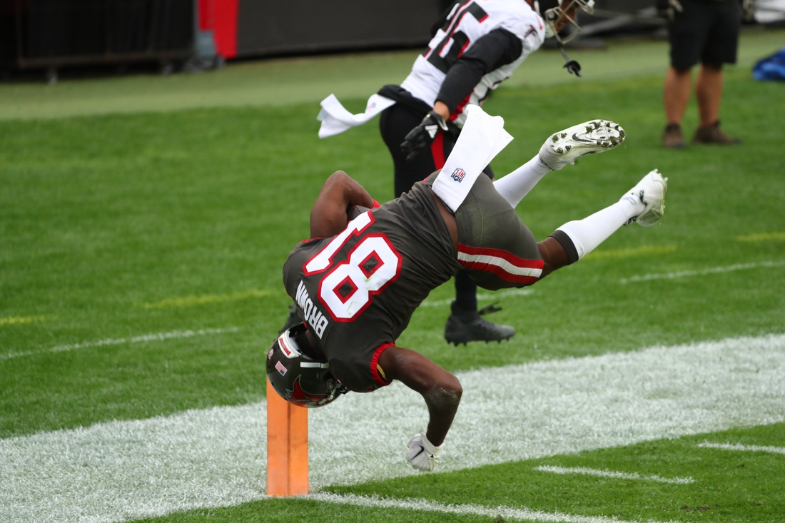 Jan 3, 2021; Tampa, Florida, USA; Tampa Bay Buccaneers wide receiver Antonio Brown (81) flips into the end zone for a touchdown against the Atlanta Falcons during the second half at Raymond James Stadium. Mandatory Credit: Kim Klement-USA TODAY Sports