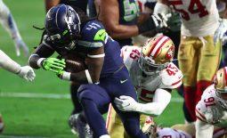 Jan 3, 2021; Glendale, Arizona, USA; Seattle Seahawks running back Alex Collins (41) is tackled by San Francisco 49ers linebacker Demetrius Flannigan-Fowles (45) at State Farm Stadium. Mandatory Credit: Mark J. Rebilas-USA TODAY Sports