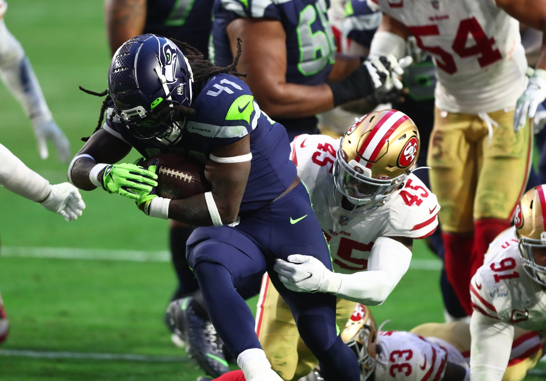 Jan 3, 2021; Glendale, Arizona, USA; Seattle Seahawks running back Alex Collins (41) is tackled by San Francisco 49ers linebacker Demetrius Flannigan-Fowles (45) at State Farm Stadium. Mandatory Credit: Mark J. Rebilas-USA TODAY Sports