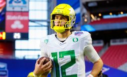 Jan 2, 2021; Glendale, AZ, USA; Oregon Ducks quarterback Tyler Shough (12) against the Iowa State Cyclones in the Fiesta Bowl at State Farm Stadium. Mandatory Credit: Mark J. Rebilas-USA TODAY Sports
