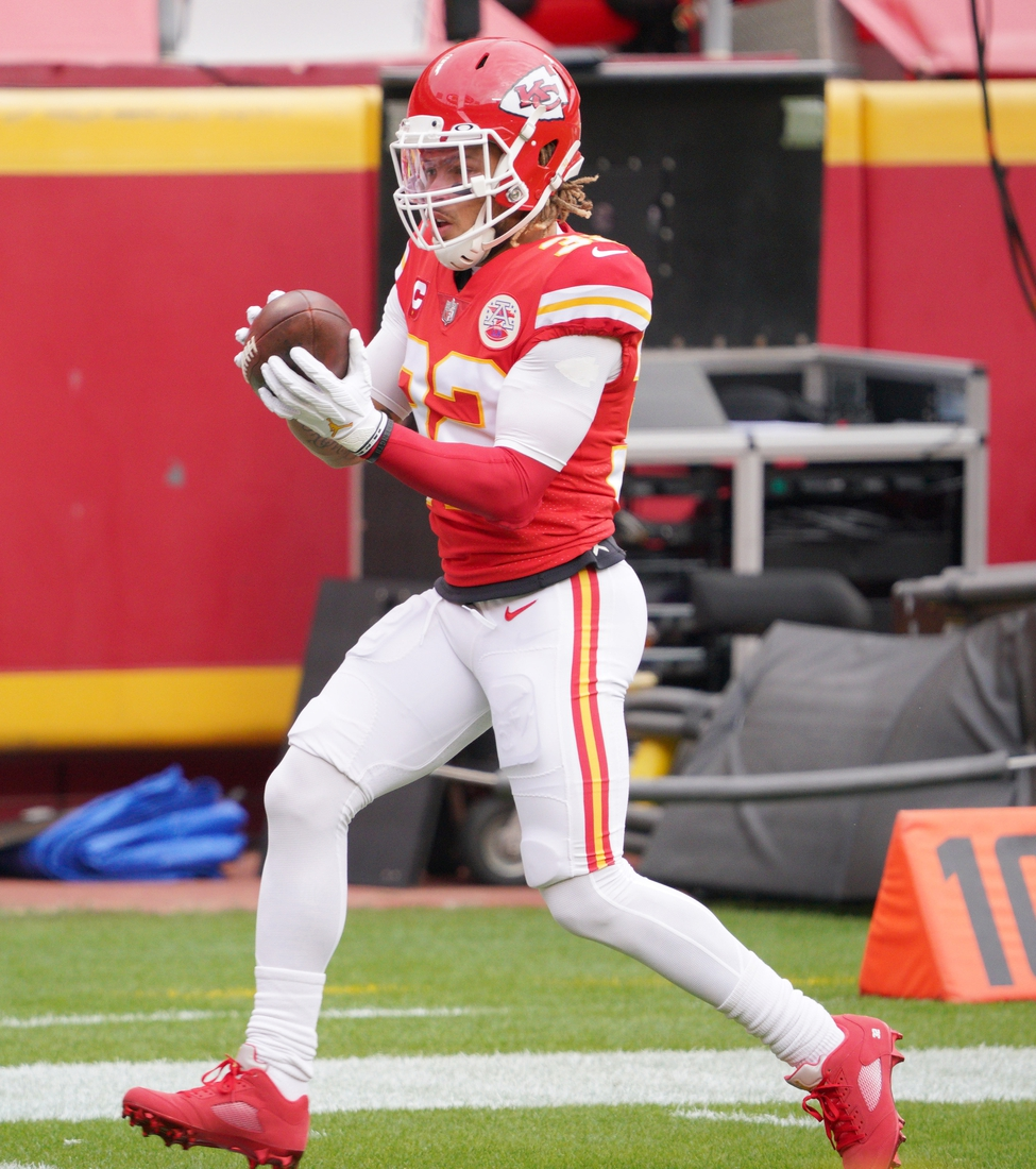 Jan 17, 2021; Kansas City, Missouri, USA; Kansas City Chiefs strong safety Tyrann Mathieu (32) warms up before the AFC Divisional Round playoff game against the Cleveland Browns at Arrowhead Stadium. Mandatory Credit: Denny Medley-USA TODAY Sports