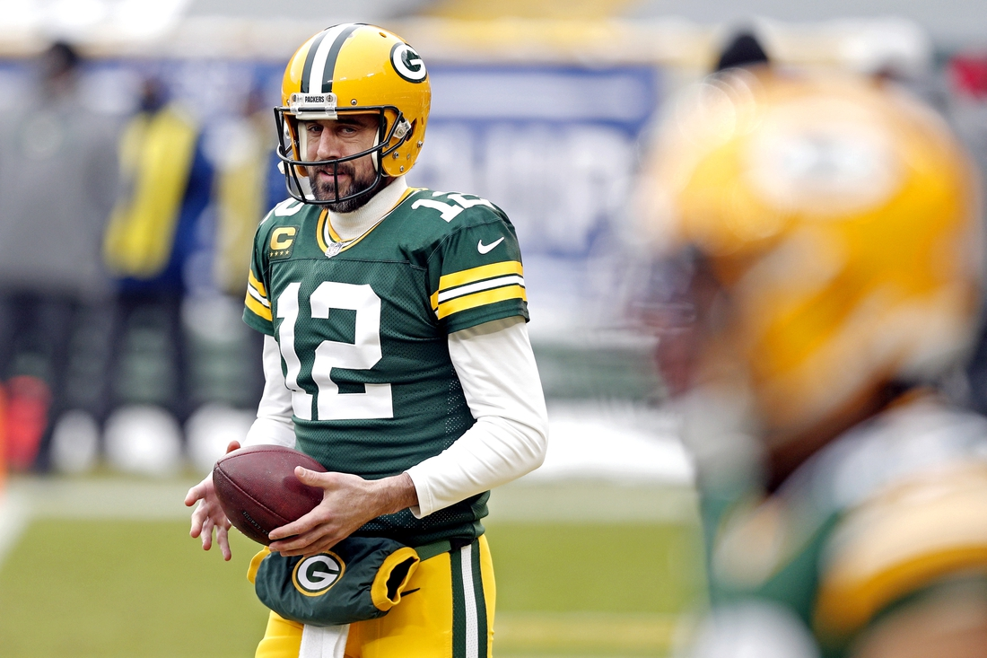 Jan 24, 2021; Green Bay, Wisconsin, USA; Green Bay Packers quarterback Aaron Rodgers (12) warms up before playing the Tampa Bay Buccaneers at Lambeau Field. Mandatory Credit: Jeff Hanisch-USA TODAY Sports