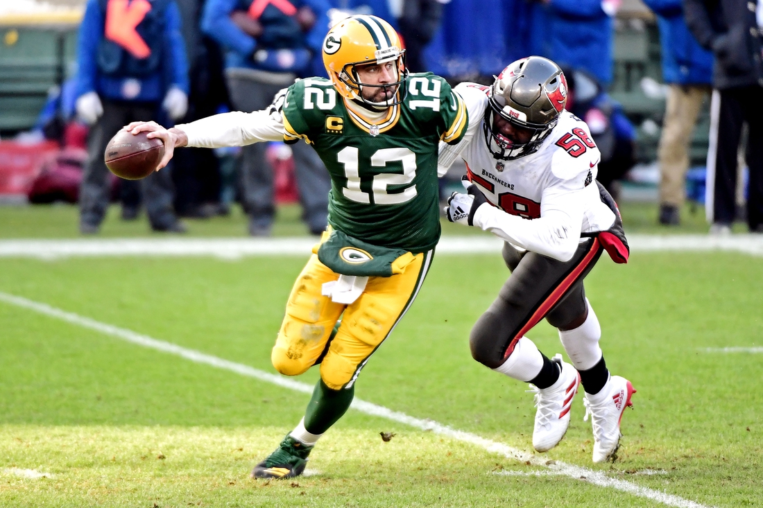Tampa Bay Buccaneers outside linebacker Jason Pierre-Paul (90) sacks Green Bay Packers quarterback Aaron Rodgers (12) during the first quarter of their NFC Championship game
