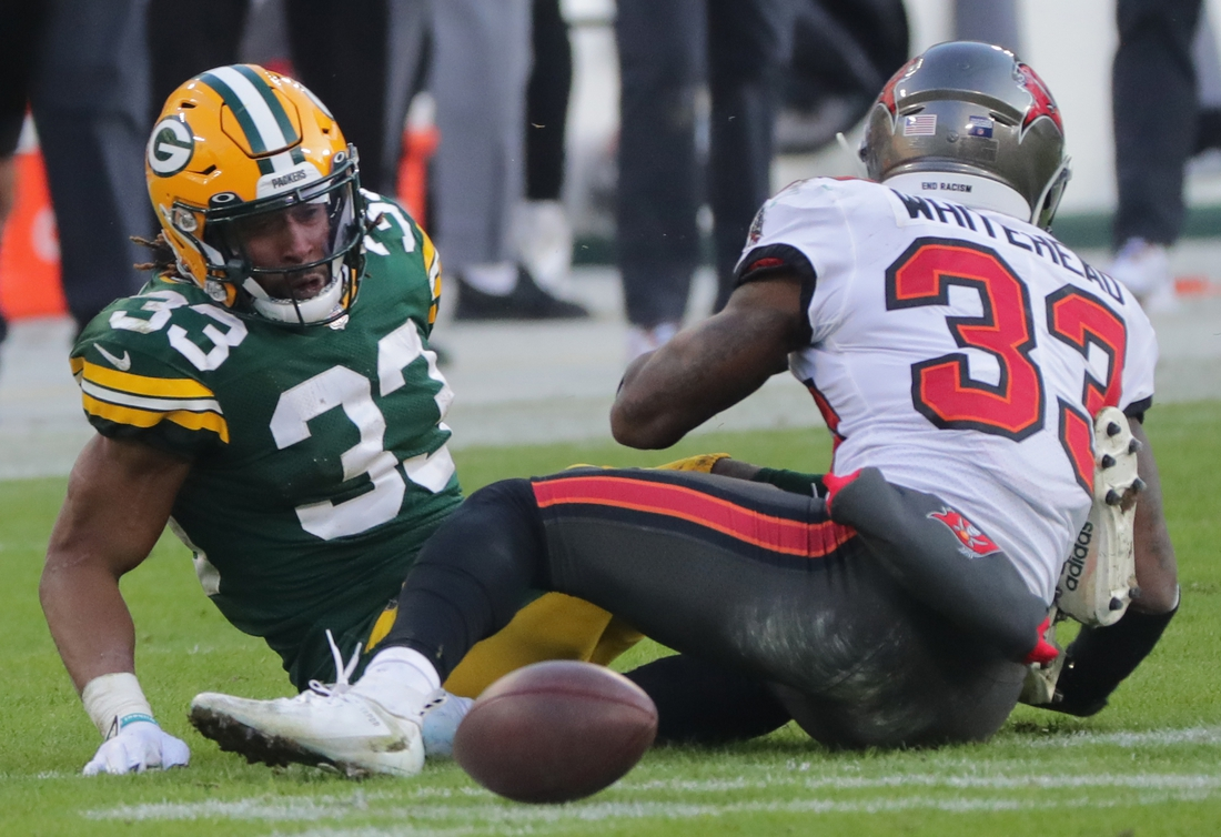 Jan 24, 2021, Green Bay, WI, USA; Green Bay Packers' Aaron Jones (33) fumbles thebasl after being drilled by Tampa Bay Buccaneers free safety Jordan Whitehead (33,white) during the third quarter of their NFC Championship game Sunday, January 24, 2021 at Lambeau Field in Green Bay, Wis. Tampa recovered  the ball and scored on the next play. The Tampa Bay Buccaneers beat the Green Bay Packers 31-26. Mandatory credit: Mark Hoffman / Milwaukee Journal Sentinel via USA TODAY NETWORK