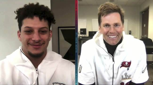 Feb 1, 2021; Tampa, FL, USA; In this still image from video provided by the NFL, Kansas City Chiefs quarterback Patrick Mahomes, left, and Tampa Bay Buccaneers quarterback Tom Brady speak during Opening Night for the NFL Super Bowl 55 football game Monday, Feb. 1, 2021.  Mandatory Credit: NFL via USA TODAY Sports