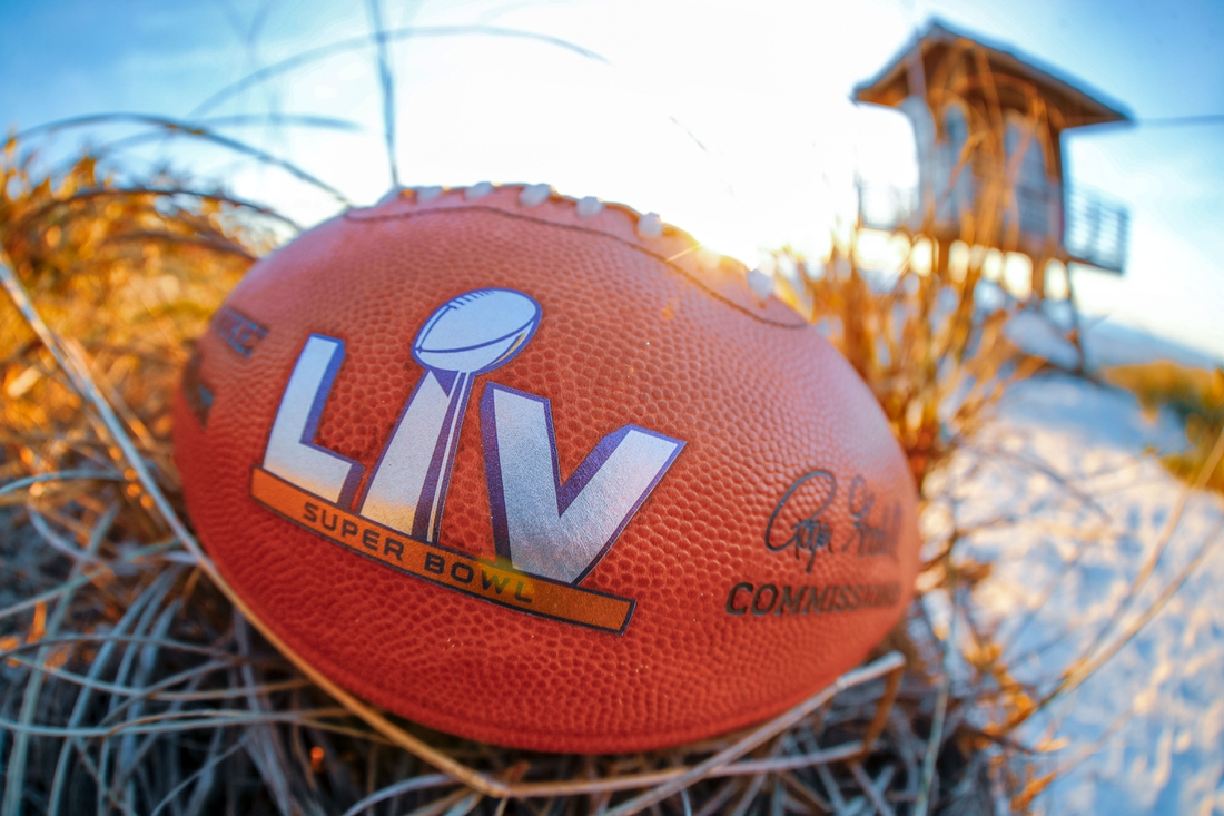 Feb 4, 2021; Tampa Bay, Florida, USA; A general view of the Super Bowl LV official football on the beach at Anna Maria Island.  Mandatory Credit: Kim Klement-USA TODAY Sports