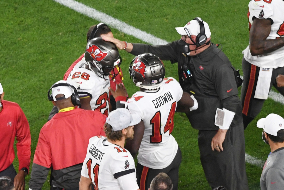 Feb 7, 2021; Tampa, FL, USA; Tampa Bay Buccaneers running back Leonard Fournette (28) is congratulated by head coach Bruce Arians (right) after a touchdown run in the third quarter of Super Bowl LV at Raymond James Stadium.  Mandatory Credit: James Lang-USA TODAY Sports