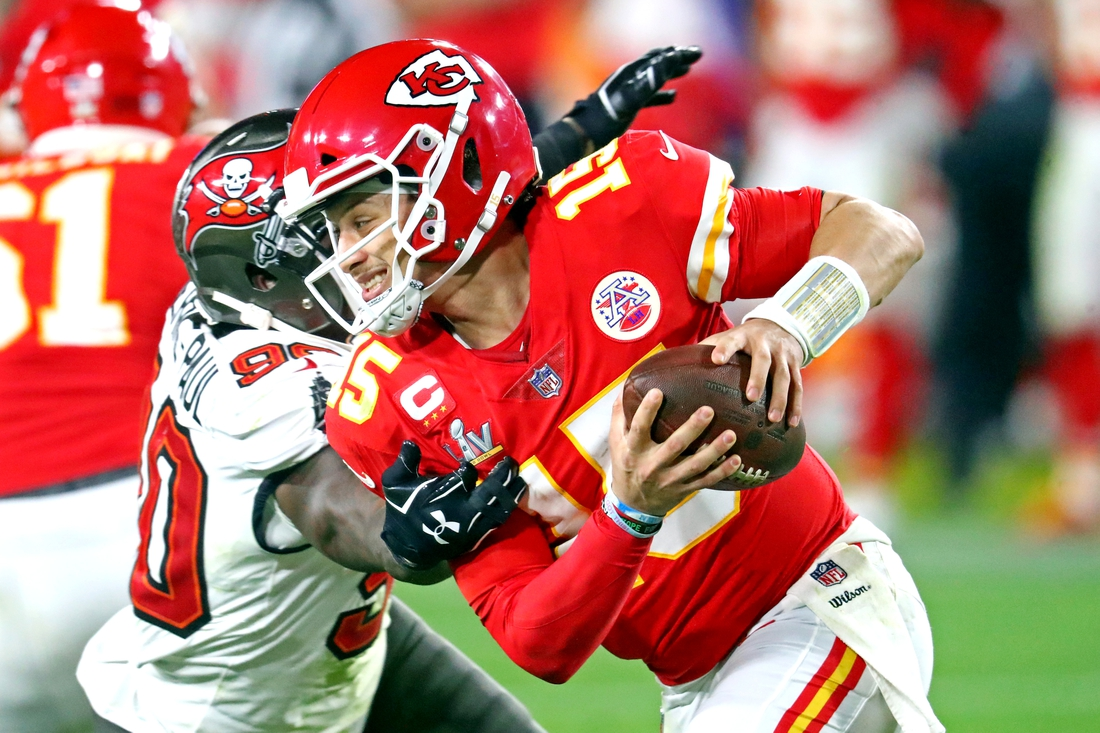 Feb 7, 2021; Tampa, FL, USA;  Kansas City Chiefs quarterback Patrick Mahomes (15) is pressures by Tampa Bay Buccaneers outside linebacker Jason Pierre-Paul (90) during the fourth quarter in Super Bowl LV at Raymond James Stadium.  Mandatory Credit: Mark J. Rebilas-USA TODAY Sports