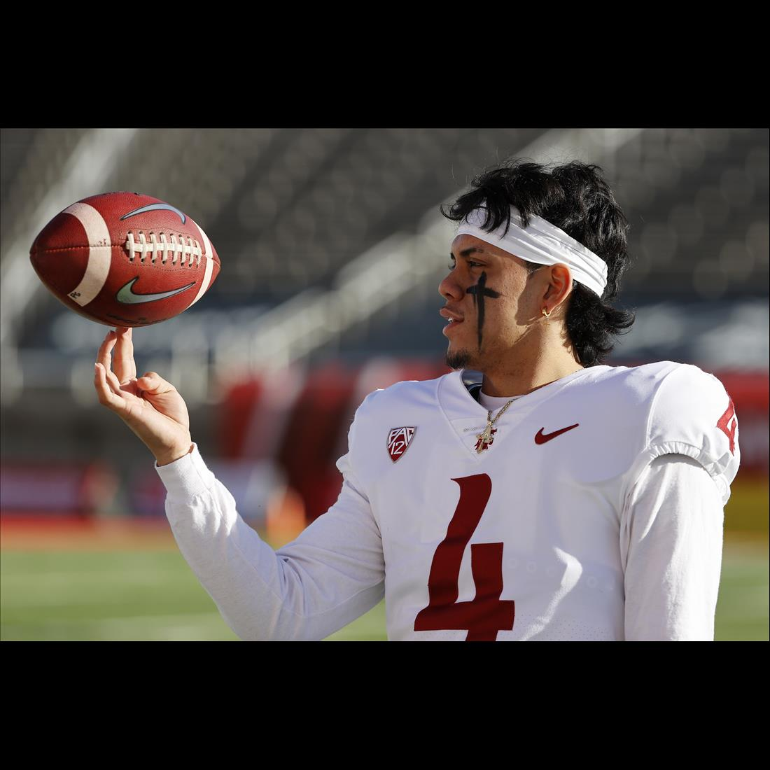 Dec 19, 2020; Salt Lake City, Utah, USA; Washington State Cougars quarterback Jayden de Laura (4) prepares for their game against the Utah Utes at Rice-Eccles Stadium. Mandatory Credit: Jeffrey Swinger-USA TODAY Sports