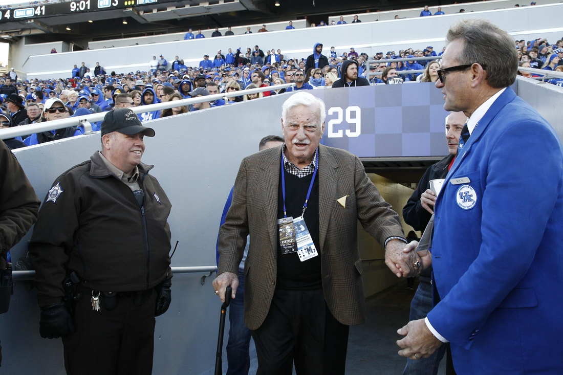 Nov 25, 2017; Lexington, KY, USA; Former Louisville Cardinals head coach Howard Schnellenberger walks out on the field during the game against the Kentucky Wildcats at Commonwealth Stadium. Louisville defeat Kentucky 44-17. Mandatory Credit: Mark Zerof-USA TODAY Sports