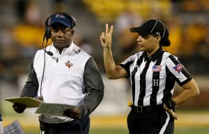 Oct 20, 2018; Hattiesburg, MS, USA; UTSA Roadrunners head coach Frank Wilson (left) talks to head linesman Maia Chaka in the second half against the Southern Miss Golden Eagles at M. M. Roberts Stadium. Mandatory Credit: Chuck Cook-USA TODAY Sports