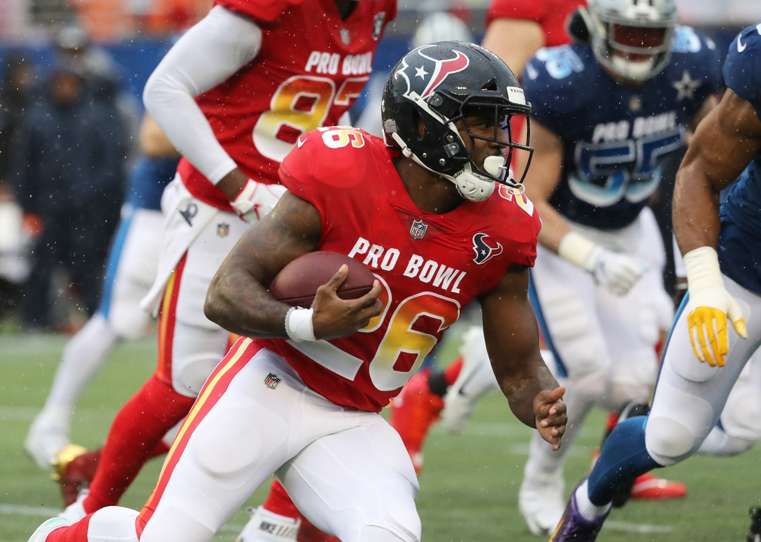 Jan 27, 2019; Orlando, FL, USA; AFC running back Lamar Miller (26) runs with the ball during the first half in the NFL Pro Bowl football game at Camping World Stadium. Mandatory Credit: Kim Klement-USA TODAY Sports