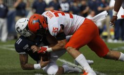 Sep 7, 2019; East Hartford, CT, USA; Illinois Fighting Illini linebacker Jake Hansen (35) sacks Connecticut Huskies quarterback Jack Zergiotis (11) in the second quarter at Pratt & Whitney Stadium at Rentschler Field. Mandatory Credit: David Butler II-USA TODAY Sports
