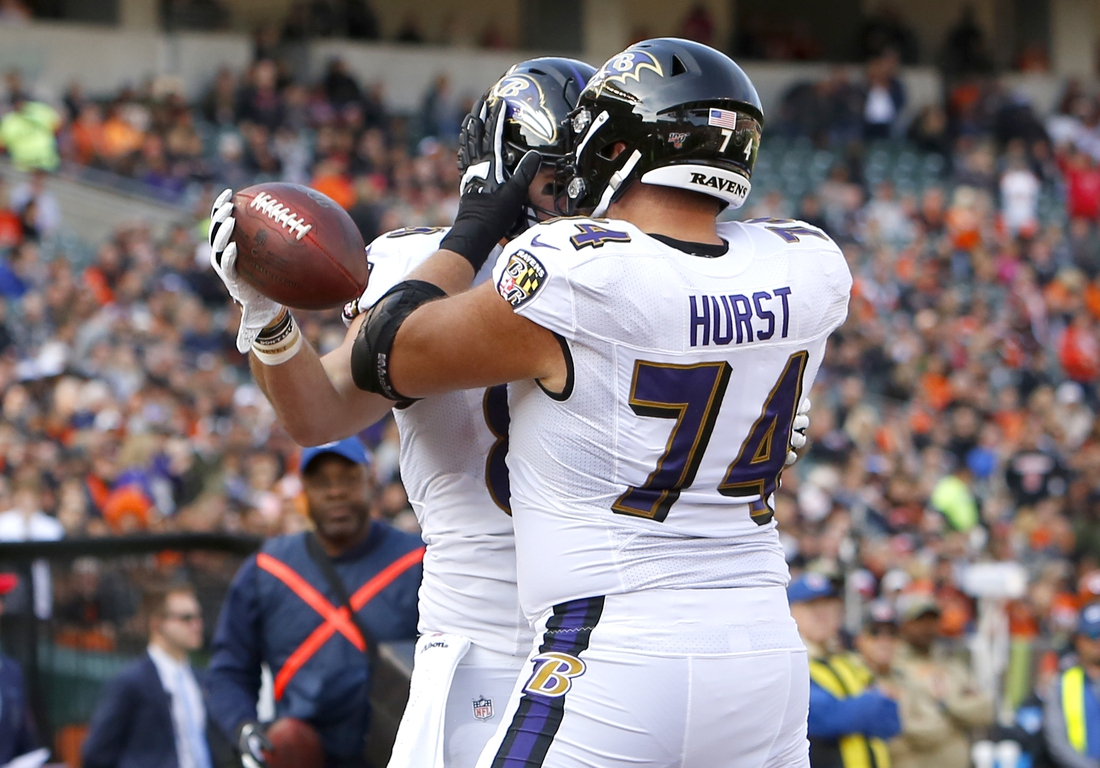 Nov 10, 2019; Cincinnati, OH, USA; Baltimore Ravens tight end Mark Andrews (89) celebrates with offensive tackle James Hurst (74) scoring a touchdown against the Cincinnati Bengals during the first half at Paul Brown Stadium. Mandatory Credit: David Kohl-USA TODAY Sports