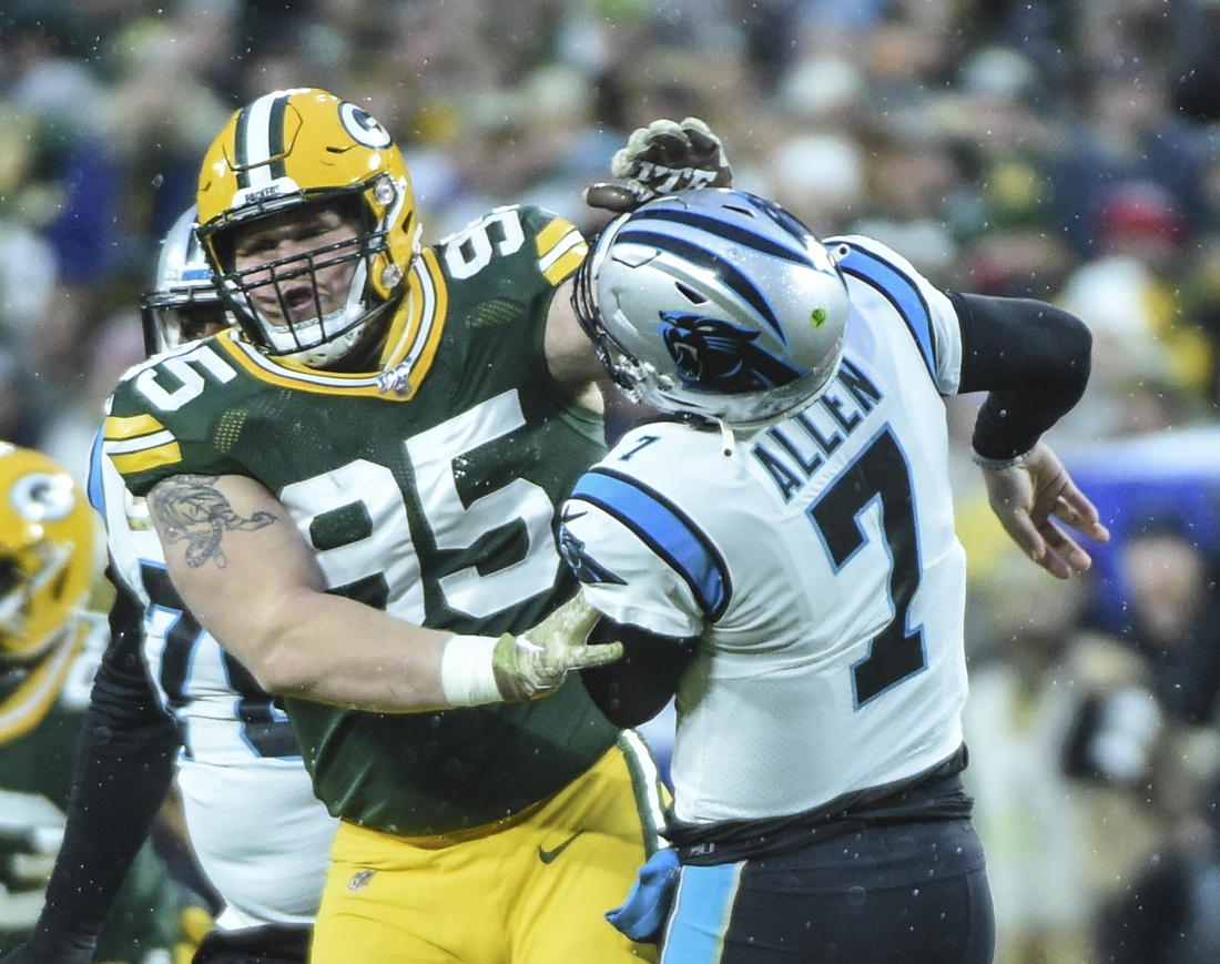 Nov 10, 2019; Green Bay, WI, USA;  Green Bay Packers defensive tackle Tyler Lancaster (95) was penalized for roughing Carolina Panthers quarterback Kyle Allen (7) in the first quarter at Lambeau Field. Mandatory Credit: Benny Sieu-USA TODAY Sports