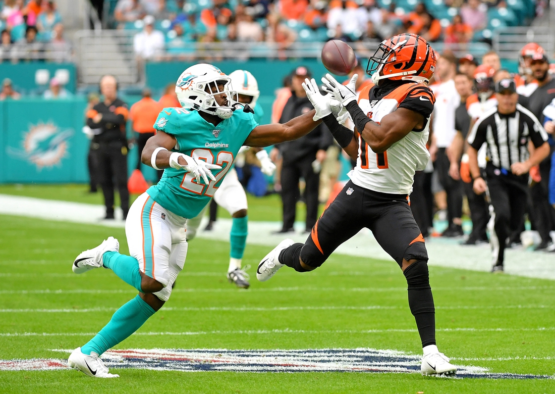 Dec 22, 2019; Miami Gardens, Florida, USA; Cincinnati Bengals wide receiver John Ross (11) hauls in a catch in front of Miami Dolphins defensive back Tae Hayes (22) during the first half at Hard Rock Stadium. Mandatory Credit: Steve Mitchell-USA TODAY Sports