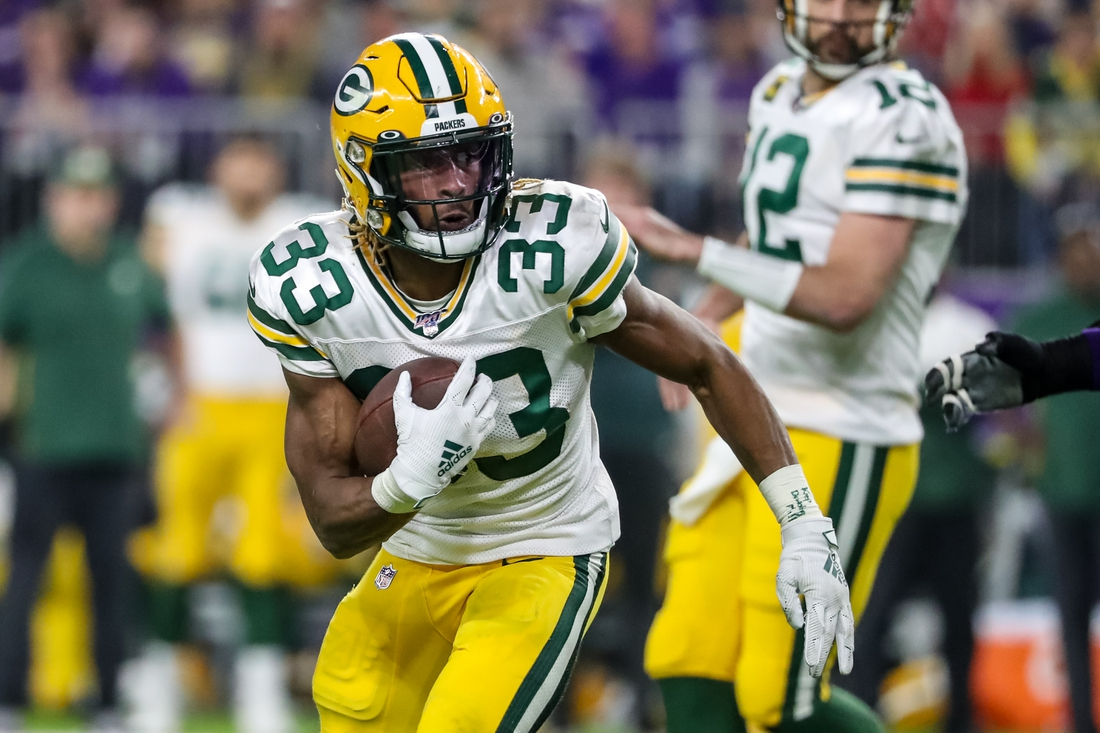Dec 23, 2019; Minneapolis, Minnesota, USA; Green Bay Packers running back Aaron Jones (33) carries the ball during the second quarter against the Minnesota Vikings at U.S. Bank Stadium. Mandatory Credit: Brace Hemmelgarn-USA TODAY Sports