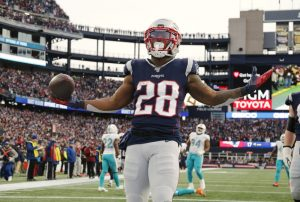 Dec 29, 2019; Foxborough, Massachusetts, USA; New England Patriots running back James White (28) celebrates a touchdown against the Miami Dolphins during the second half at Gillette Stadium. Mandatory Credit: Winslow Townson-USA TODAY Sports
