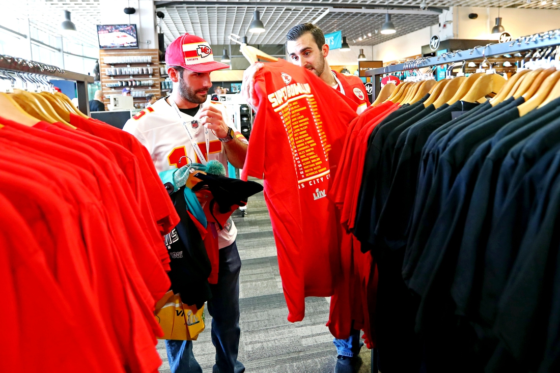 Feb 2, 2020; Miami Gardens, Florida, USA; Fans look throw merchandise before Super Bowl LIV between the San Francisco 49ers and the Kansas City Chiefs at Hard Rock Stadium. Mandatory Credit: Kim Klement-USA TODAY Sports