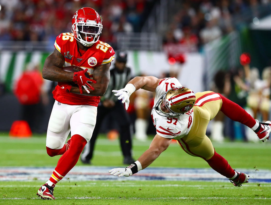 Feb 2, 2020; Miami Gardens, Florida, USA; Kansas City Chiefs running back Damien Williams (26) runs with the ball in the fourth quarter against San Francisco 49ers defensive end Nick Bosa (97) in Super Bowl LIV at Hard Rock Stadium. Mandatory Credit: Matthew Emmons-USA TODAY Sports
