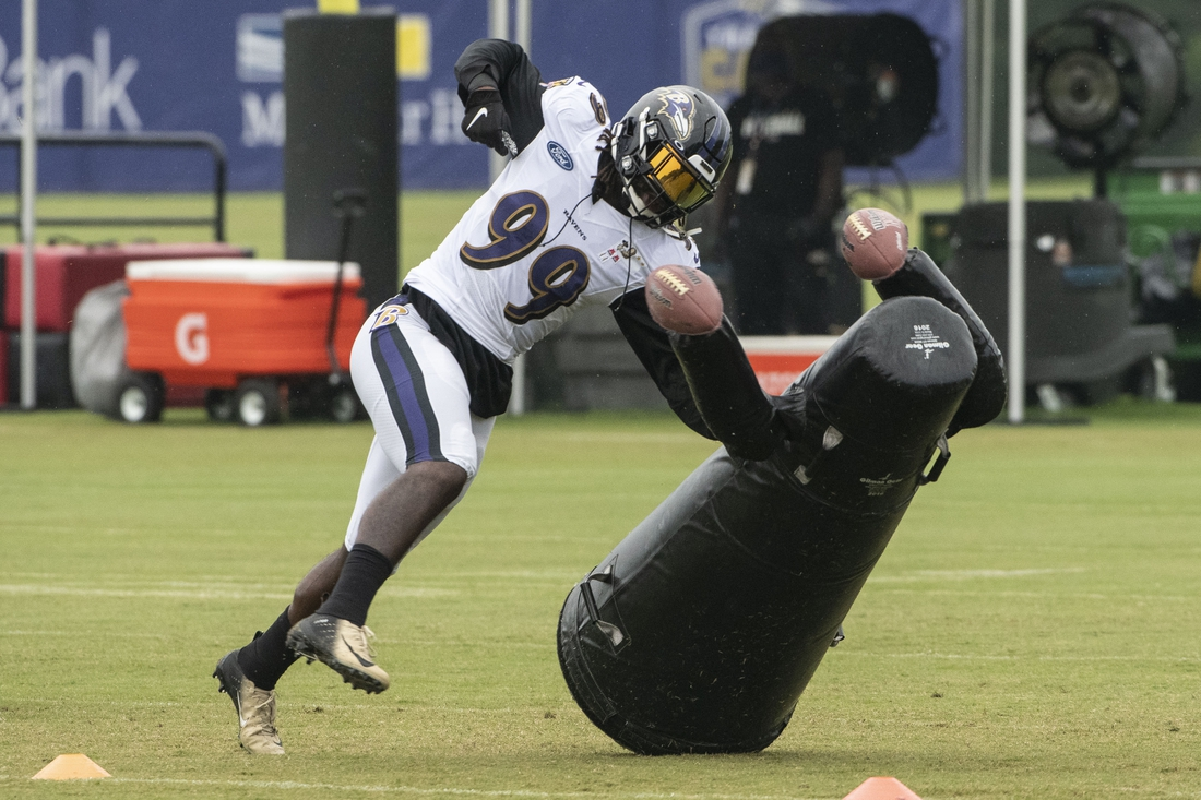Aug 19, 2020; Owings Mills, Maryland, USA; Baltimore Ravens linebacker Matthew Judon (99) takes part in defensive drills during the morning session of training camp at Under Armour Performance Center. Mandatory Credit: Tommy Gilligan-USA TODAY Sports