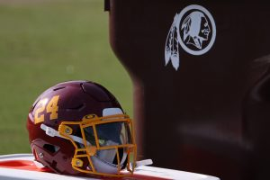 Aug 20, 2020; Ashburn, Virginia, USA; The helmet of Washington Football Team running back Antonio Gibson (not pictured) rests on a cooler next to a trashcan with the retired Washington Redskins logo on day twenty-three of training camp at Inova Sports Performance Center in Ashburn, Virginia. Mandatory Credit: Geoff Burke-USA TODAY Sports