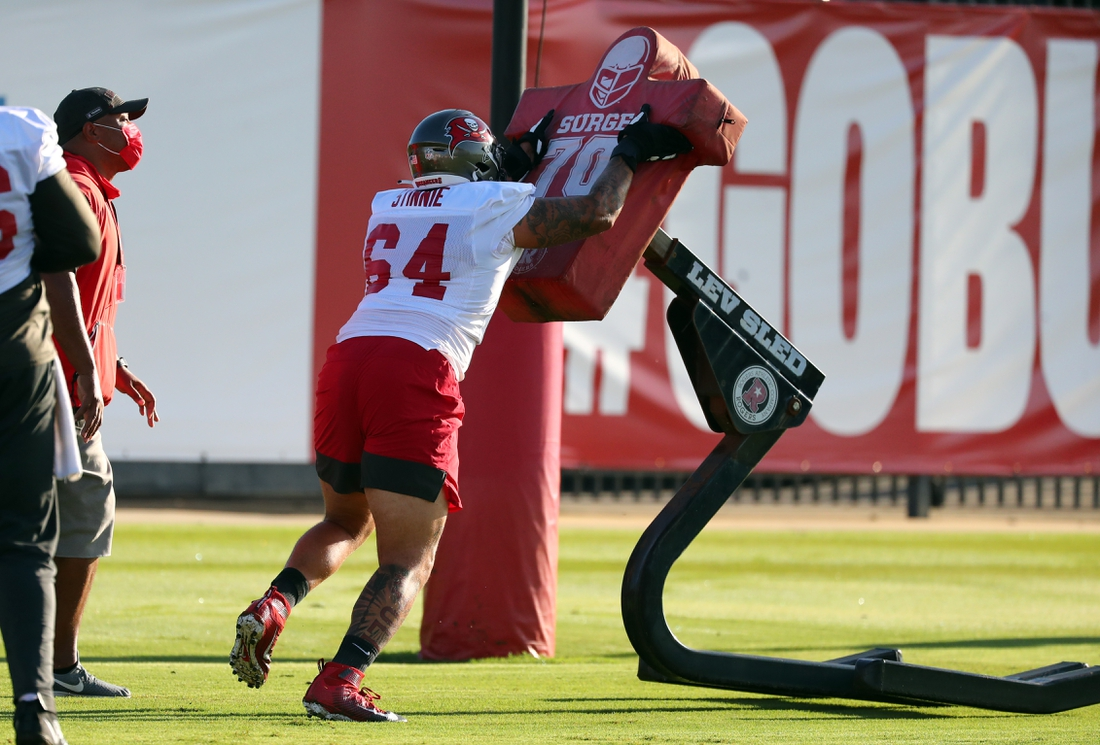 Sep 2, 2020; Tampa, Florida, USA;  Tampa Bay Buccaneers guard Aaron Stinnie (64) works out at AdventHealth Training Center. Mandatory Credit: Kim Klement-USA TODAY Sports