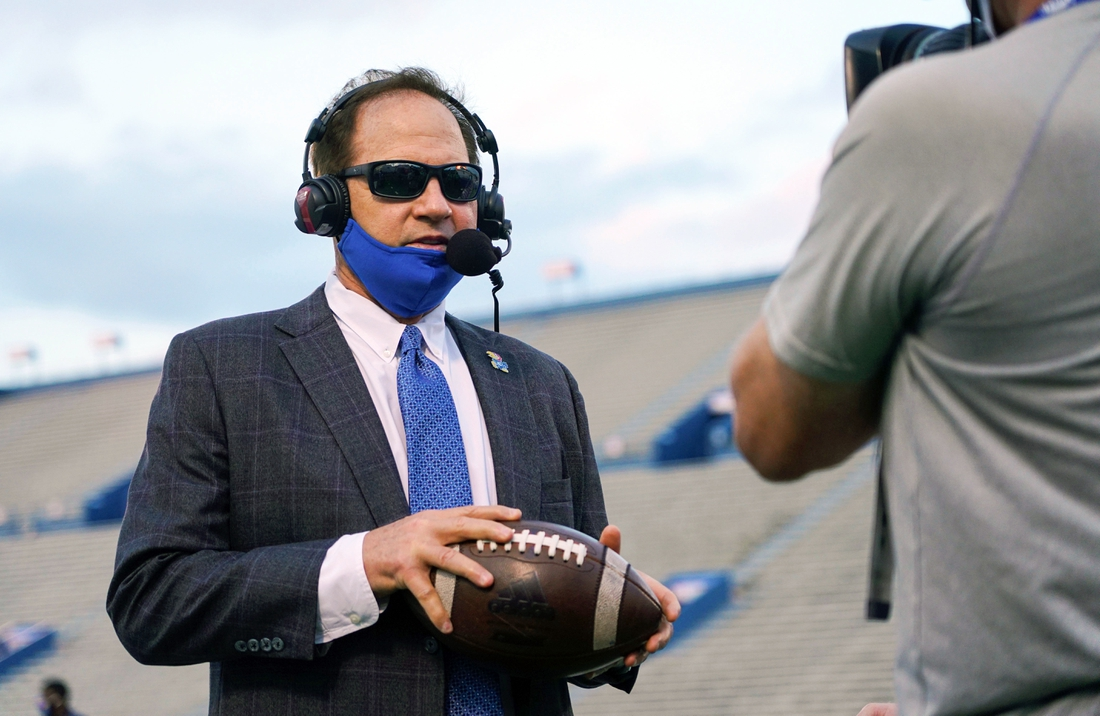 Sep 12, 2020; Lawrence, Kansas, USA; Kansas Jayhawks head coach Les Miles is interviewed before a game against the Coastal Carolina Chanticleers at David Booth Kansas Memorial Stadium. Mandatory Credit: Jay Biggerstaff-USA TODAY Sports