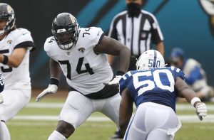 Sep 13, 2020; Jacksonville, Florida, USA;  Jacksonville Jaguars offensive tackle Cam Robinson (74) protects the line from the rushing Indianapolis Colts defensive end Justin Houston (50) during the second half at TIAA Bank Field. Mandatory Credit: Reinhold Matay-USA TODAY Sports