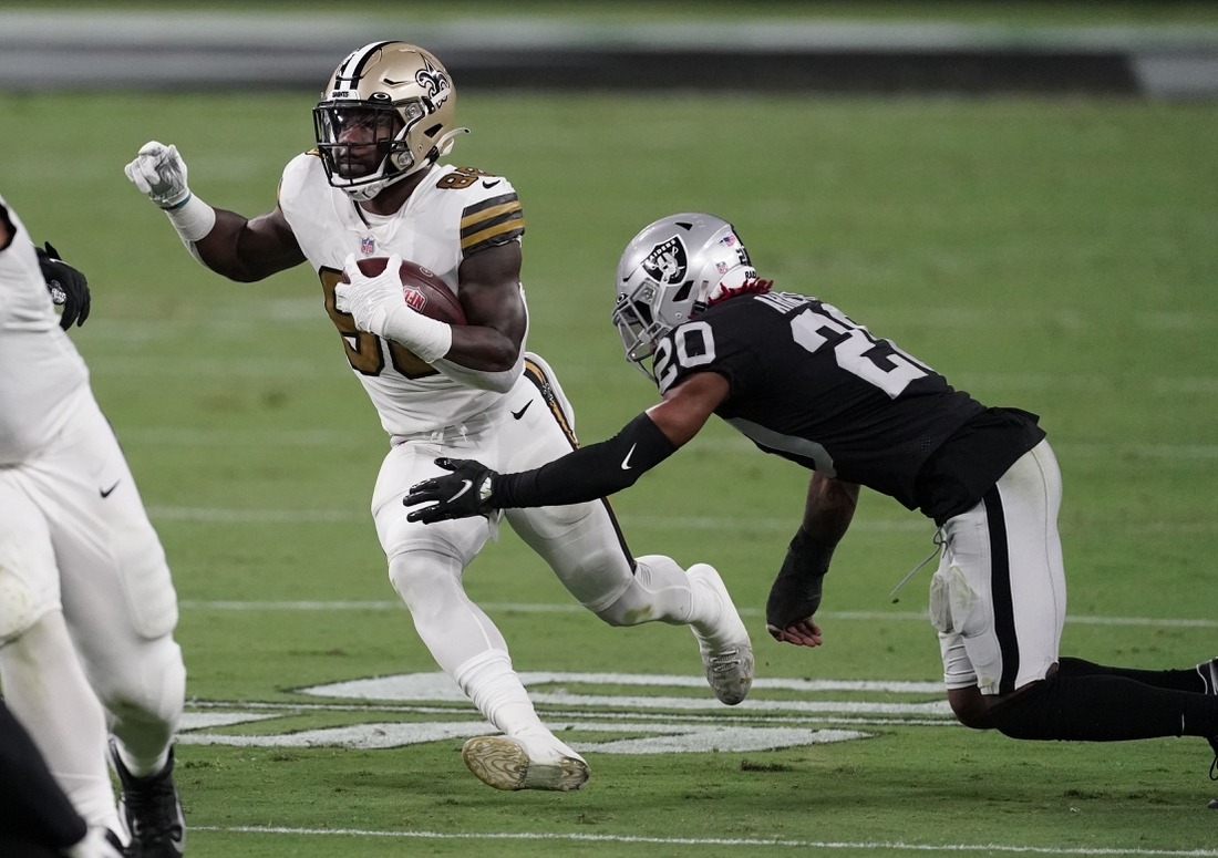 Sep 21, 2020; Paradise, Nevada, USA;  New Orleans Saints running back Ty Montgomery (88) runs the ball against Las Vegas Raiders cornerback Damon Arnette (20) during the third quarter of a NFL game at Allegiant Stadium. Mandatory Credit: Kirby Lee-USA TODAY Sports