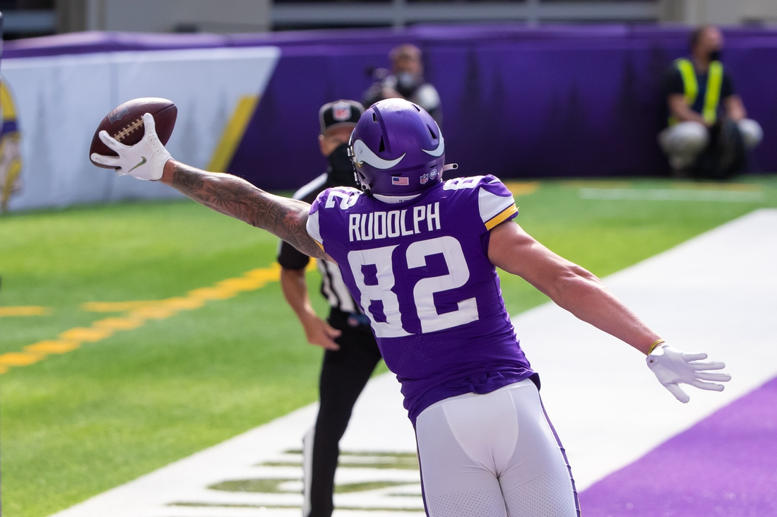 Sep 27, 2020; Minneapolis, Minnesota, USA; Minnesota Vikings tight end Kyle Rudolph (82) catches a pass for a touchdown in the fourth quarter against the Tennessee Titans at U.S. Bank Stadium. Mandatory Credit: Brad Rempel-USA TODAY Sports