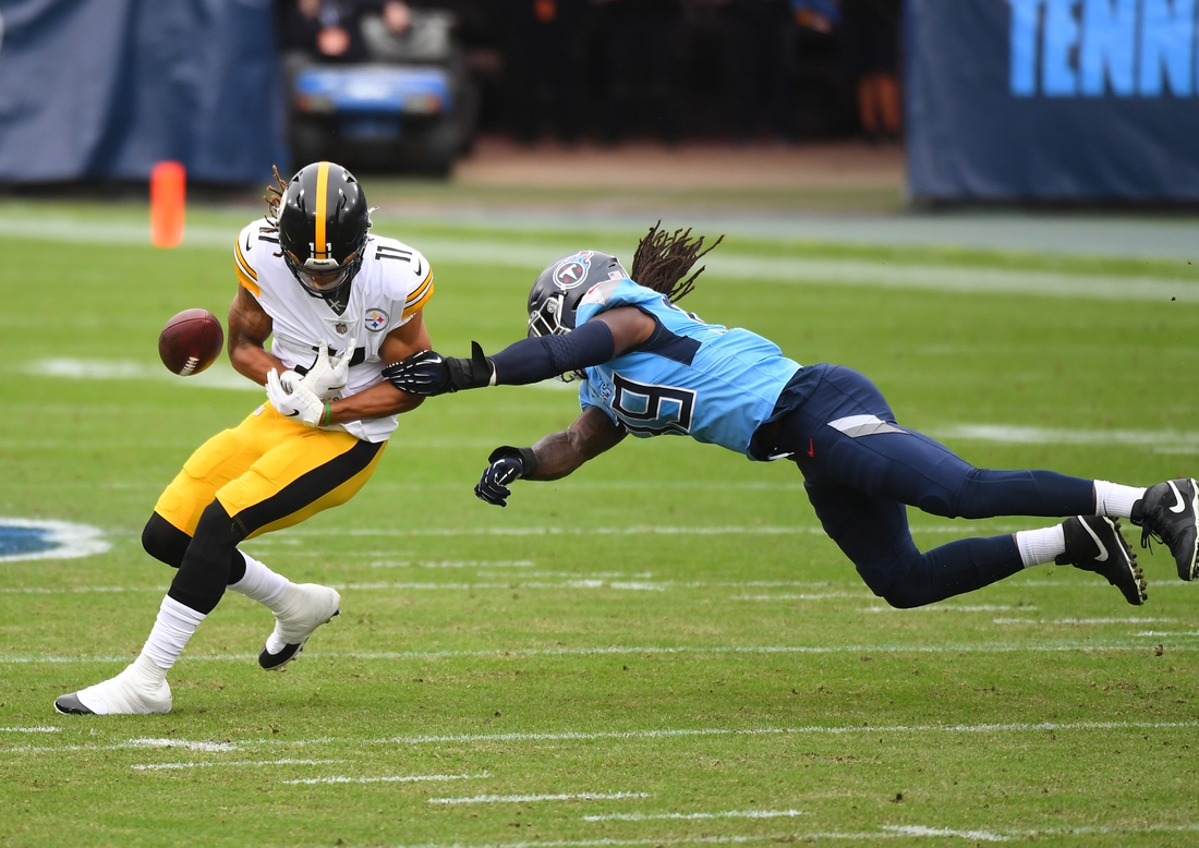 Oct 25, 2020; Nashville, Tennessee, USA; Tennessee Titans outside linebacker Jadeveon Clowney (99) forces a fumble by Pittsburgh Steelers wide receiver Chase Claypool (11) during the first half at Nissan Stadium. Mandatory Credit: Christopher Hanewinckel-USA TODAY Sports