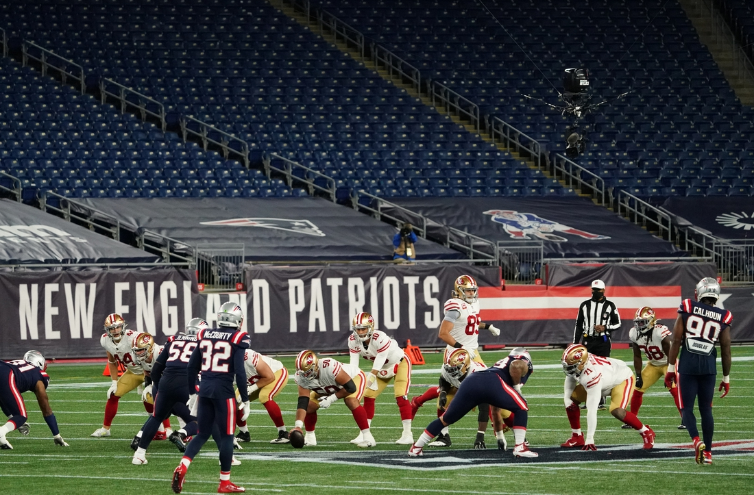 Oct 25, 2020; Foxborough, Massachusetts, USA; San Francisco 49ers quarterback Jimmy Garoppolo (10) at the line of scrimmage as they take on the New England Patriots during the second half in an empty stadium due to Covid19 restrictions at Gillette Stadium. Mandatory Credit: David Butler II-USA TODAY Sports