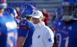 Oct 31, 2020; Lawrence, Kansas, USA; Kansas Jayhawks head coach Les Miles watches team warm ups before the game against the Iowa State Cyclones at David Booth Kansas Memorial Stadium. Mandatory Credit: Denny Medley-USA TODAY Sports