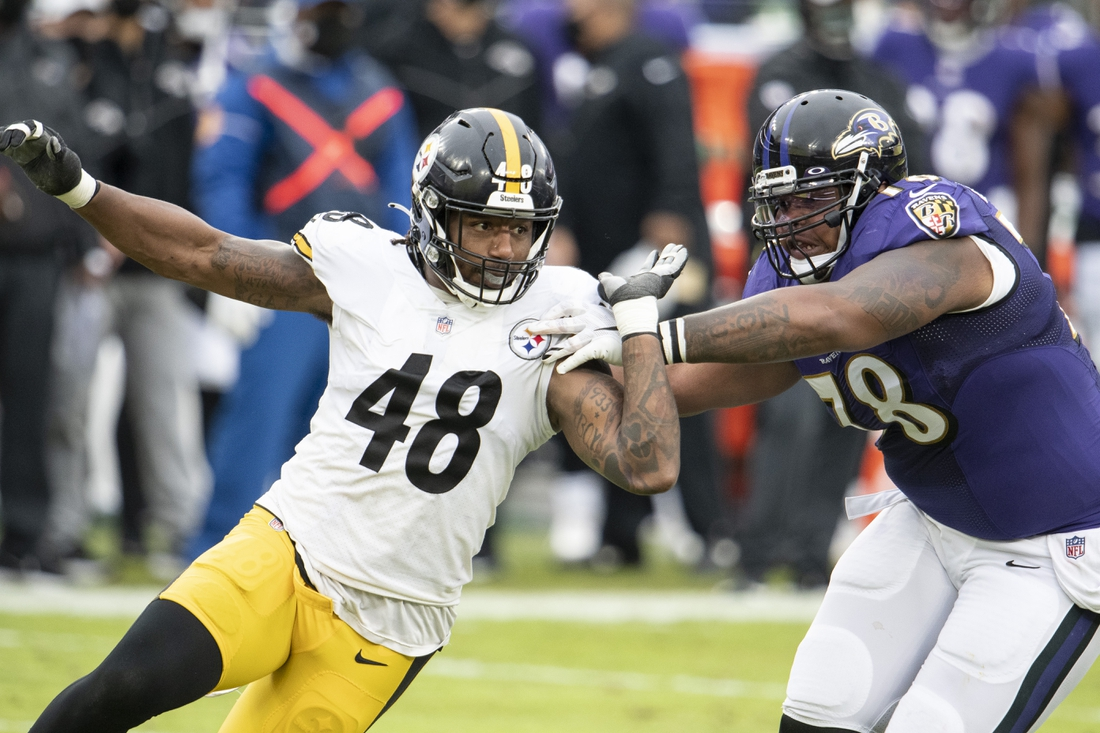Nov 1, 2020; Baltimore, Maryland, USA;  Pittsburgh Steelers outside linebacker Bud Dupree (48) rushes as Baltimore Ravens offensive tackle Orlando Brown (78) blocks during the first half at M&T Bank Stadium. Mandatory Credit: Tommy Gilligan-USA TODAY Sports