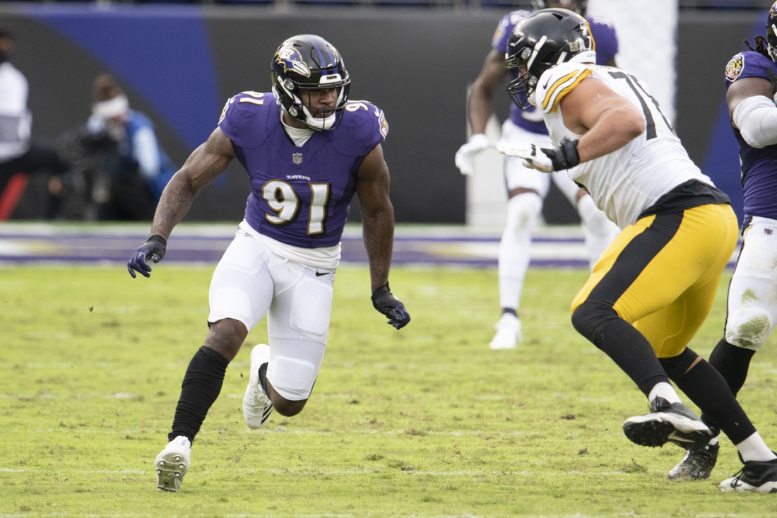 Nov 1, 2020; Baltimore, Maryland, USA; Baltimore Ravens defensive end Yannick Ngakoue (91) rushes during the second half as Pittsburgh Steelers offensive tackle Alejandro Villanueva (78) blocks at M&T Bank Stadium. Mandatory Credit: Tommy Gilligan-USA TODAY Sports