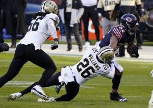 Nov 1, 2020; Chicago, Illinois, USA; Chicago Bears running back David Montgomery (32) breaks the tackle of New Orleans Saints cornerback P.J. Williams (26) during the first quarter at Soldier Field. Mandatory Credit: Mike Dinovo-USA TODAY Sports