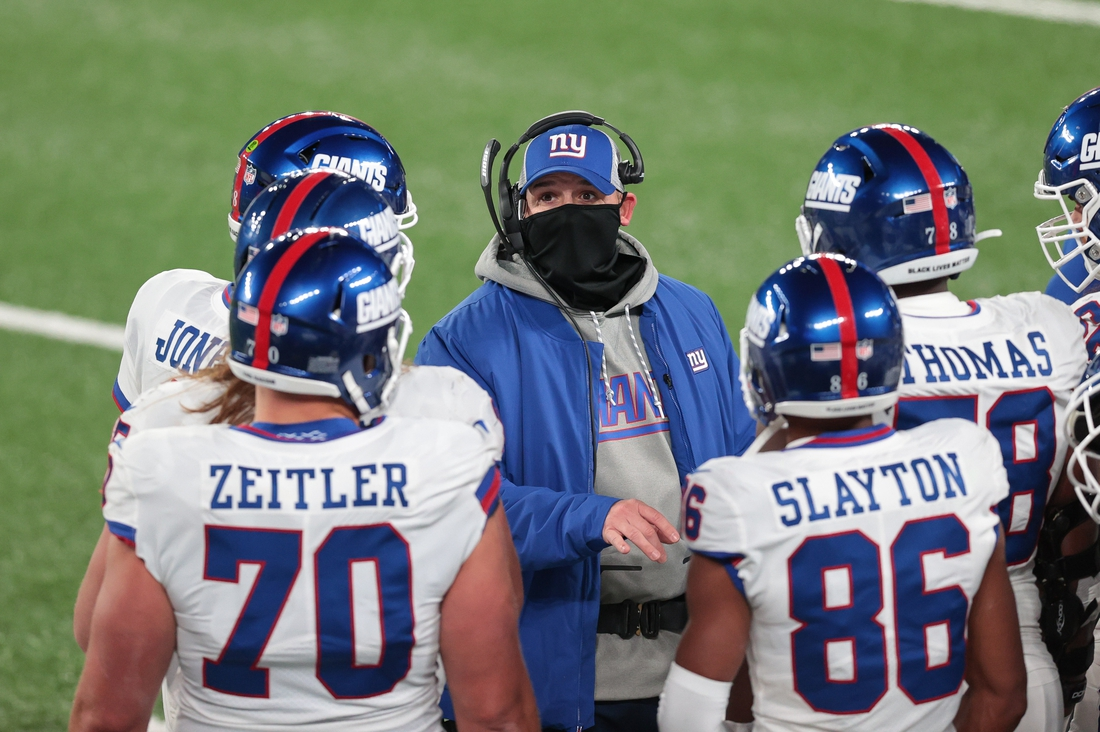Nov 2, 2020; East Rutherford, New Jersey, USA; New York Giants head coach Joe Judge talks with guard Kevin Zeitler (70) and wide receiver Darius Slayton (86) and long snapper Casey Kreiter (58) during the second half against the Tampa Bay Buccaneers at MetLife Stadium. Mandatory Credit: Vincent Carchietta-USA TODAY Sports