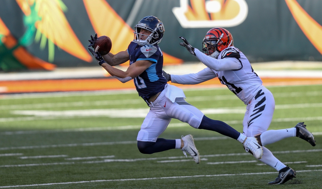 Nov 1, 2020; Cincinnati, Ohio, USA; Tennessee Titans wide receiver Adam Humphries (10) attempts to catch a pass against the Cincinnati Bengals in the first half at Paul Brown Stadium. Mandatory Credit: Katie Stratman-USA TODAY Sports