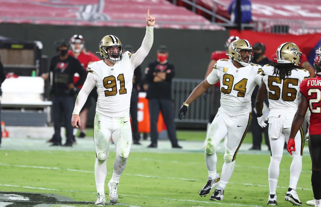 Nov 8, 2020; Tampa, Florida, USA; New Orleans Saints defensive end Trey Hendrickson (91) celebrates as he makes a sack against the Tampa Bay Buccaneers during the second half at Raymond James Stadium. Mandatory Credit: Kim Klement-USA TODAY Sports