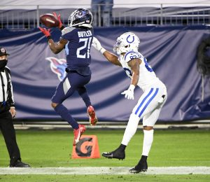 Nov 12, 2020; Nashville, Tennessee, USA; Tennessee Titans cornerback Malcolm Butler (21) makes the interception in front of Indianapolis Colts wide receiver Marcus Johnson (83) but ruled out of bounds during the second half at Nissan Stadium. Mandatory Credit: Steve Roberts-USA TODAY Sports